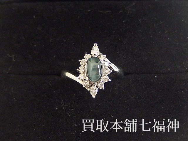 キャッツアイ効果のトルマリンとメレダイヤが付いているプラチナリング